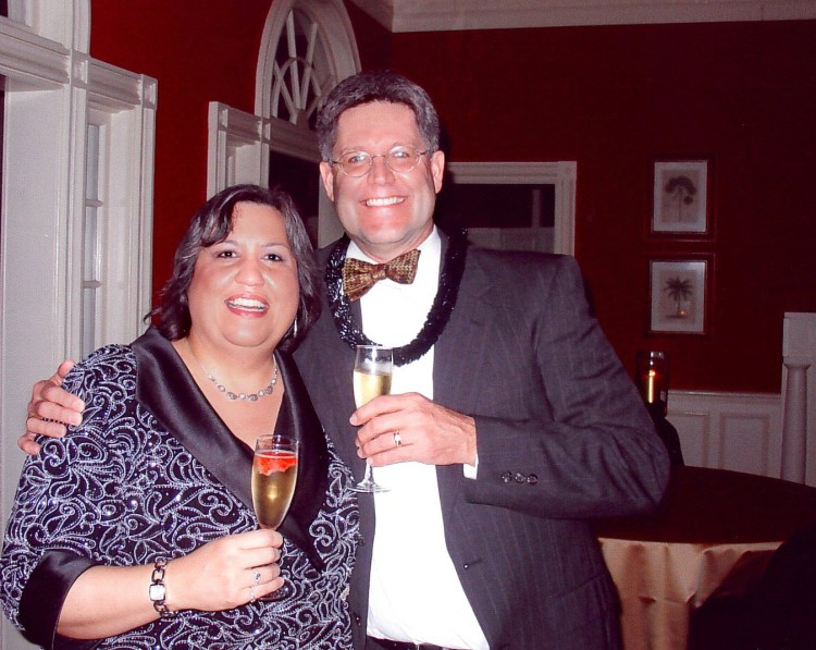 Two people celebrating New Year's Eve with glass of champagne