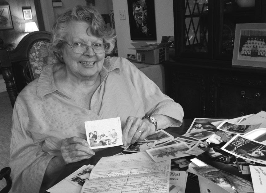Mom holding black white photo